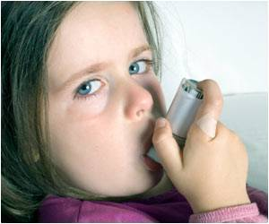 Kid With Inhaler Researchers Look for Clues to Rising Child Asthma Rates in Urban Areas
