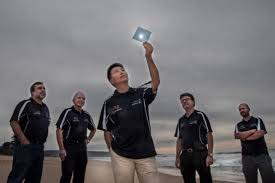 The UOW researchers and the flexible water splitting polymer. Picture credit UOW