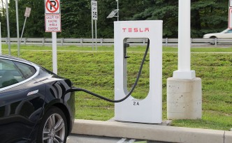 Tesla Model S Demonstrating Electric Vehicle Fast Charging on a Tesla Supercharger