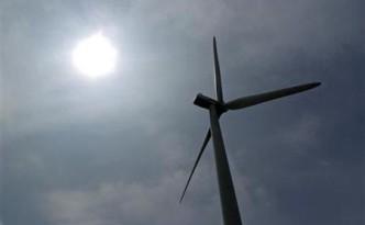 A power-generating windmill turbine operates in a wind farm on Backbone Mountain near Thomas, West Virginia