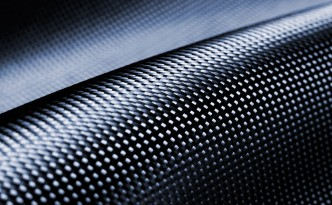 Look for fuel economy boosting carbon fiber in future Ford vehicles, but not aluminum.