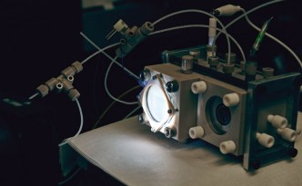 The device used by Yang in which light sensitive nanowire electrode and bacteria catalyst coverts water and Carbon dioxide into HydroCarbon gas