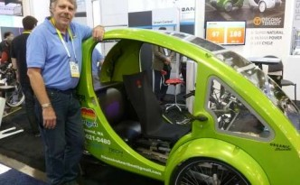 Craig Sparks shows off Organic Transit's Elf vehicle, a solar powered bicycle.