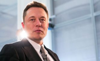 """Elon Musk, billionaire and chief executive officer of Tesla Motors Inc., arrives for a news conference in Berlin, Germany, on Thursday, Sept. 24, 2015. Tesla Motors Inc. chief executive officer Elon Musk said revelations that Volkswagen AG cheated on diesel emission tests is """"obviously bad,"""" but that the issue the world should really be concerned about is carbon dioxide emissions. Photographer: Krisztian Bocsi/Bloomberg via Getty Images"""